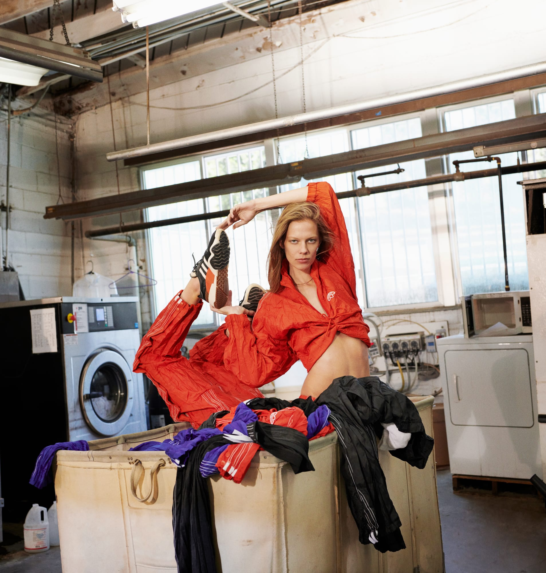 more photos c53e1 f5a25 ... a factory-based office, and now, an industrial laundromat, where Lexi  Boling and Cat McNeil pose and play dress-up on ironing boards, countertops  and ...